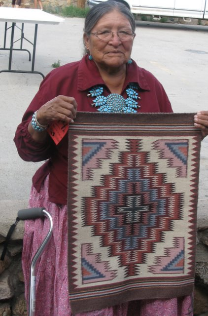 Rose Yazzie with Burntwater rug.