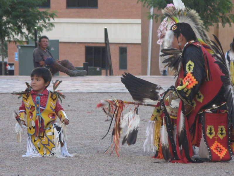 A young dancer learns his moves at the nighly Gallup Native American dance series.