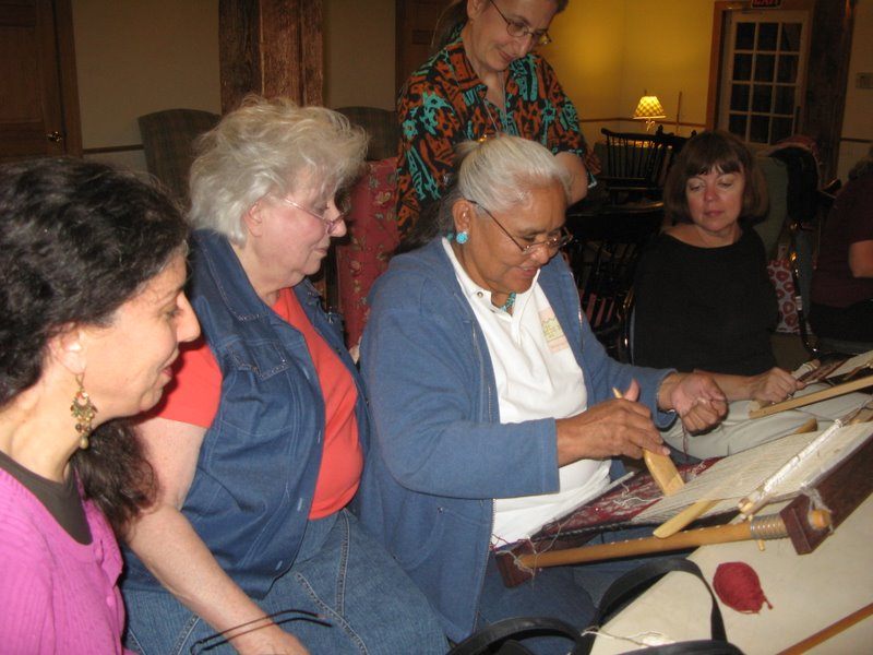 Jennie Slick demonstrates weaving for our workshop class. From left are Cheryl Holbert, Carole Kosturko, Jennie and Pat Shea.