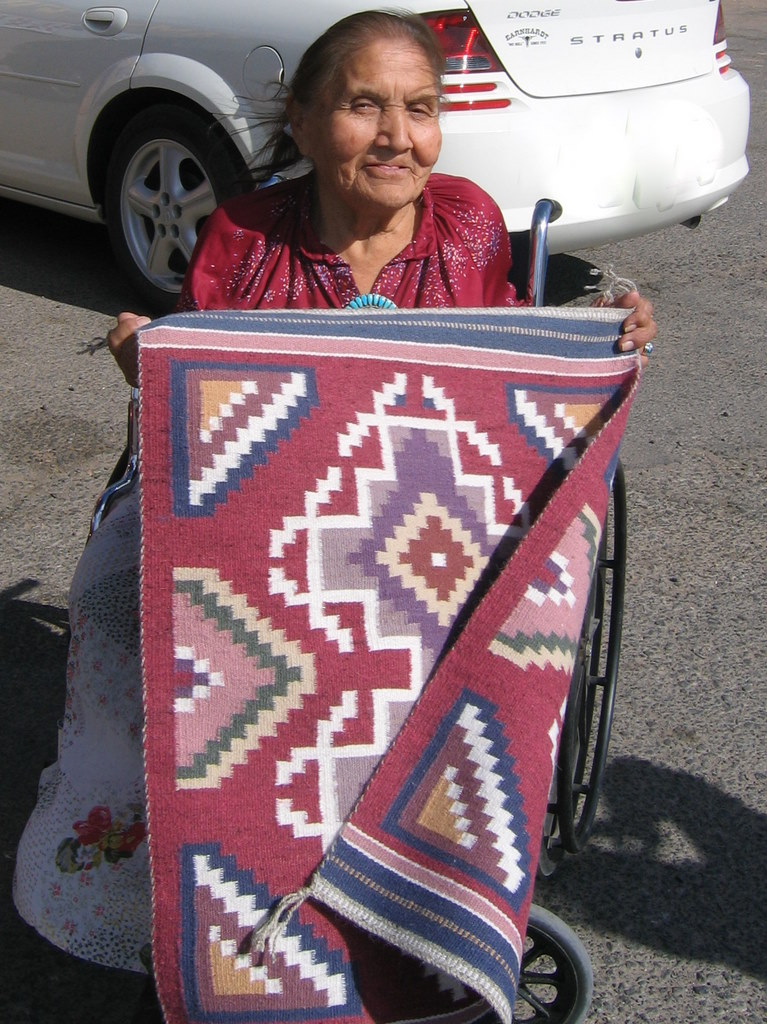 Bah Yazzie Ashley with a small Burntwater rug
